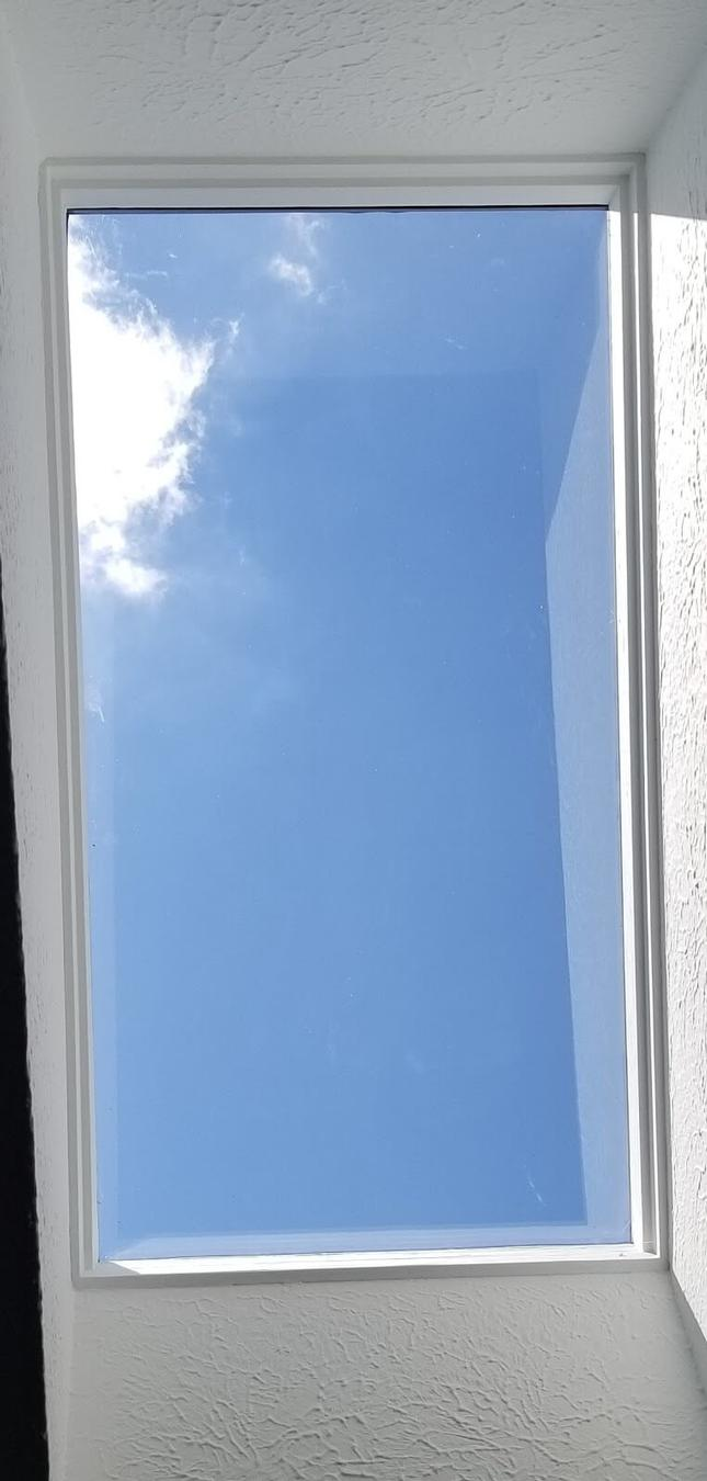 Skylight repaired with new glass in Penfield, New York.