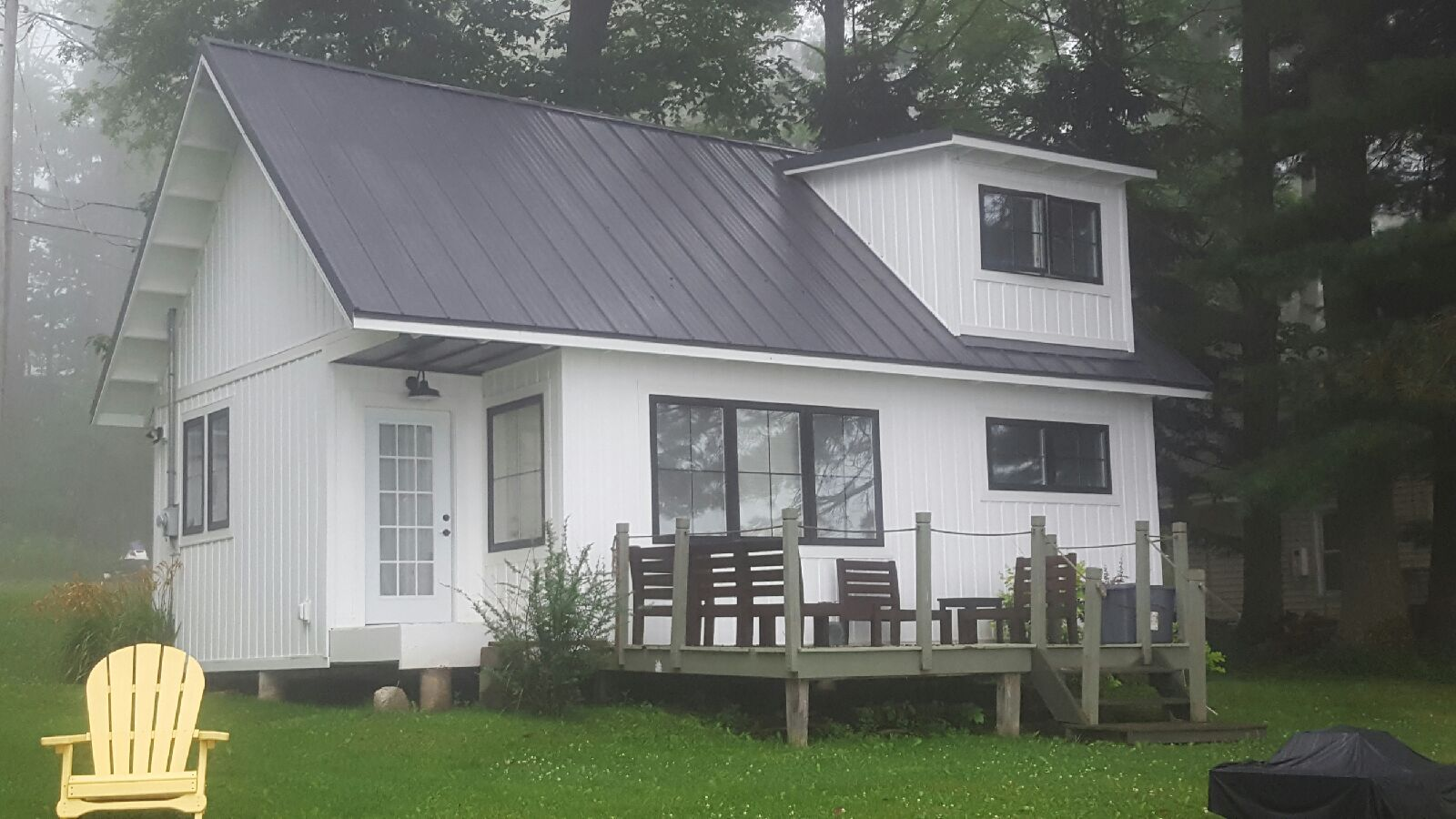 New flat metal roof on the back of a Silver Lake cottage in Perry, NY.