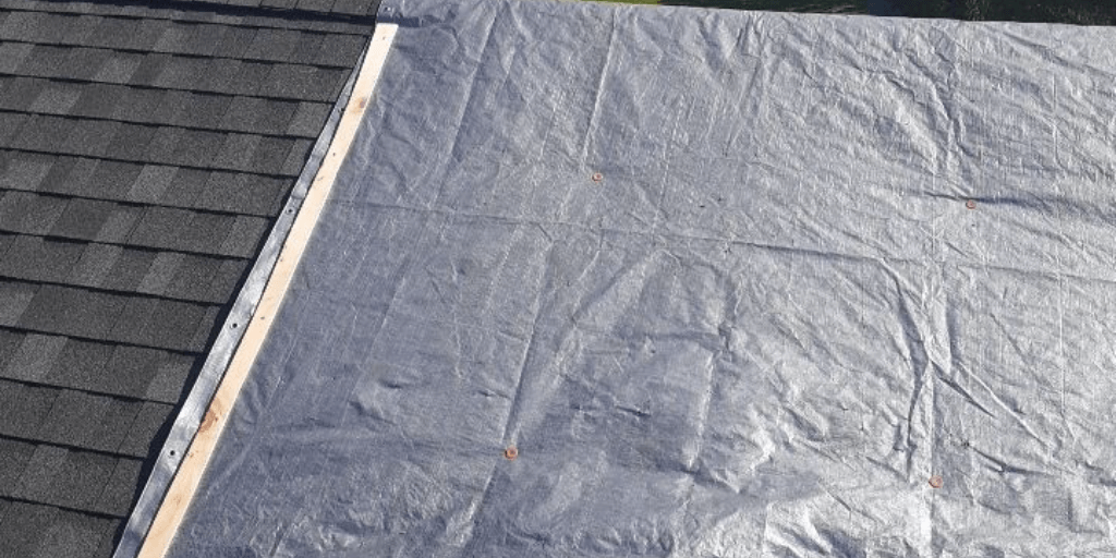 old roof covered with a tarp.